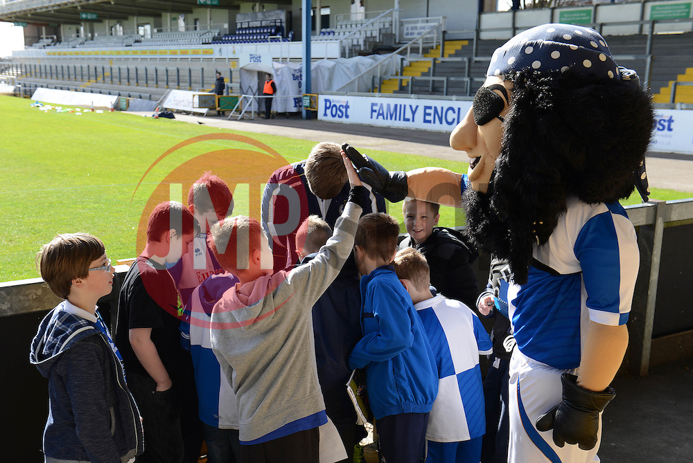 Bristol Rovers fan high fives the mascot - Photo mandatory by-line: Dougie Allward/JMP - Mobile: 07966 386802 - 31/03/2015 - SPORT - Football - Bristol - Memorial Stadium - Vanarama Football Conference - Bristol Rovers Open Training Session