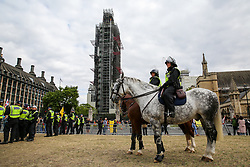 © Licensed to London News Pictures. 07/09/2019. London, UK. Large police and police horses presence in Parliament Square as a cordon is set up around Pro Brexit protesters. Photo credit: Dinendra Haria/LNP