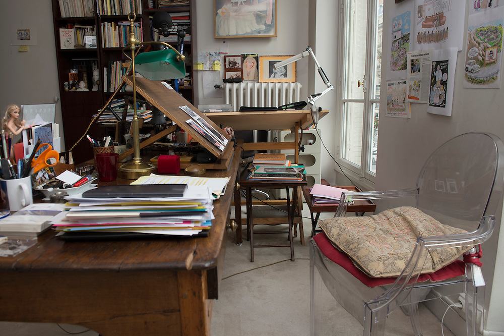 "March 11, 2015, Paris, France.  The now empty studio of Charlie Hebdo cartoonist Georges Wolinksi.  Since January 7th little has changed in the Paris' apartment where Georges Wolinski (1934 –2015) and  Maryse Wolinski (1943, Algiers) used to live. Two month after the death of Georges Wolinski, the apartment is full of souvenirs and notes, attesting a half-century-long love relation. In 2016 Maryse Wolinski published the book ""Chérie, je vais à Charlie"" about her husband and the attack on Charlie Hebdo. The cartoonist Georges Wolinski was 80 years old when he was murdered by the French jihadists Chérif en Saïd Kouachi, he was one of the 12 victims of the massacre in the Charlie Hebdo offices on January 7, 2015 in Paris. Charlie Hebdo published caricatures of Mohammed, considered blasphemous by some Muslims. During his life, Georges Wolinski defended freedom, secularism and humour and was one of the major political cartoonists in France. The couple was married and had lived for 47 years together. Photo: Steven Wassenaar."