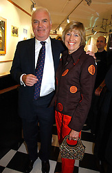 JAMES & JANIE OSBOURNE at the opening of Jack O'Shea's butcher, Montpelier Street, London on 9th November 2006.  <br />