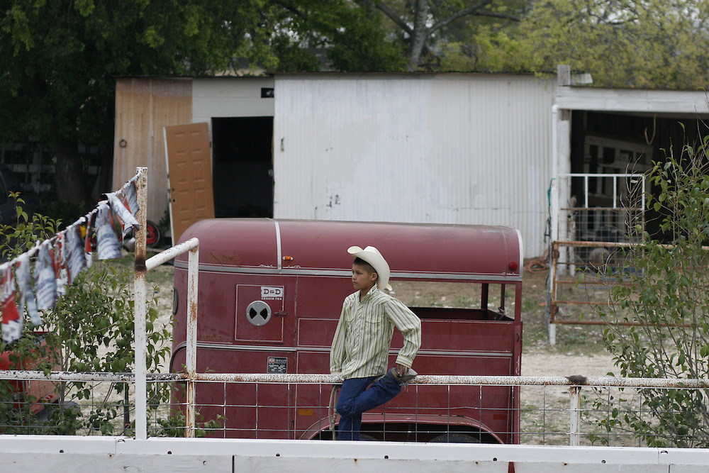 Julia Robinson photo.A young boy watches the coleadero from the sidelines at Rodeo Los Corrales in Comfort, Texas.