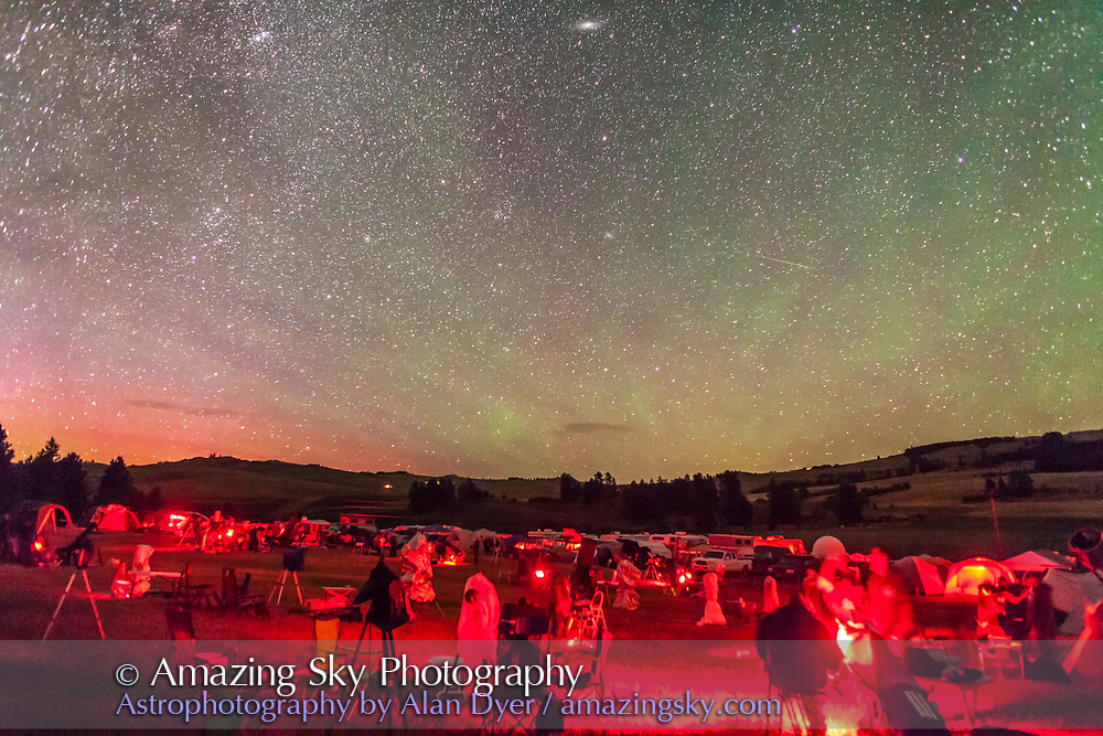 The observing field with the backdrop of the autumn sky rising and bands of airglow, at the Table Mountain Star Party at the Eden Valley Guest Ranch near Oroville, Washington, July 24, 2014. A single 20-second exposure, untracked, at f/2.2 with the 24mm lens at Canon 5D MkII at ISO 6400.