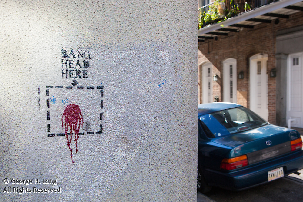 "Graffiti states ""Bang head here"""