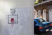 """Graffiti states """"Bang head here"""""""