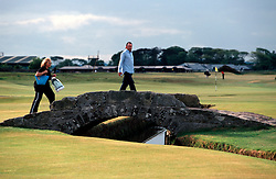UK SCOTLAND ST ANDREWS 1-2JUN04 -  Golfers cross the old stone bridge on the Old Course of St. Andrews. The Royal and Ancient Golf Club of St. Andrews, Fife, Scotland is celebrating its 250th anniversary this year and is the governing authority for the rules of the game in more than 100 affiliated nations and is responsible for the Open Championship and key amateur and international events. The R & A is also dedicated to the development of golf world-wide and is a leader in environmental and ecological research.......jre/Photo by Jiri Rezac....© Jiri Rezac 2004....Contact: +44 (0) 7050 110 417..Mobile:  +44 (0) 7801 337 683..Office:  +44 (0) 20 8968 9635....Email:   jiri@jirirezac.com..Web:     www.jirirezac.com....© All images Jiri Rezac 2004 - All rights reserved...