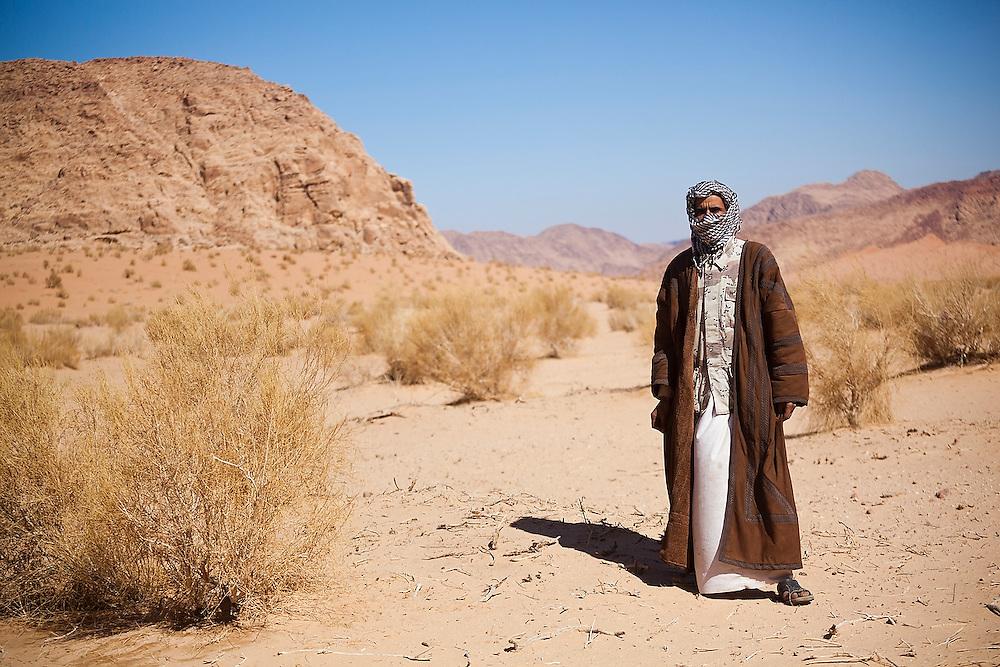 Bedouin guide Etzal Salem stands in the desert near his family's home in Wadi Rum, Jordan.