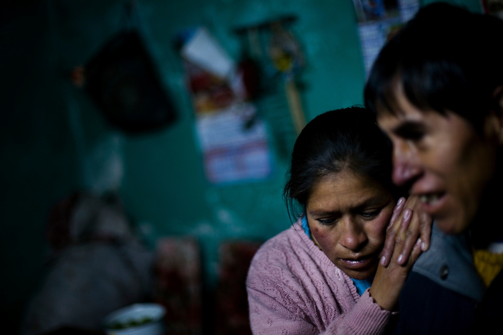 Angelica and Melliton River stand in their home in La Oroya. They have 4 children, the oldest of whom has blood lead levels more than 4 times the international standard.
