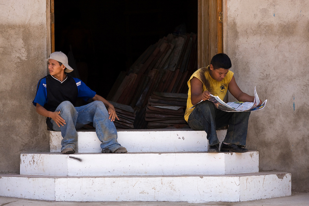 Workers take a break and read the newspaper. They are working on renovating a traditional colonial building in Granada, Nicaragua. There is an on going atmosphere of renovation in this town. Granada is Nicaragua's most famous city. founded in 1524 it is one of best examples of Spanish colonial architecture in the Americas. .it has a varied history including its almost total destruction by filibuster William Walker in a childlike tantrum. Today it is a popular tourist town though retains a strong sense of its own identity.