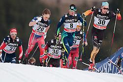 10.01.2015, Langlaufstadion, Lago di Tesero, ITA, FIS Tour de Ski, Langlauf Herren, Mass Start 15Km, im Bild Tscharnke Tim (Ger) leading the group // during the Men 15 km Cross Country of the FIS Tour de Ski 2015 at the Cross Country Stadium, Lago di Tesero, Italy on 2015/01/10. EXPA Pictures ©  2013, PhotoCredit: EXPA/ Federico Modica