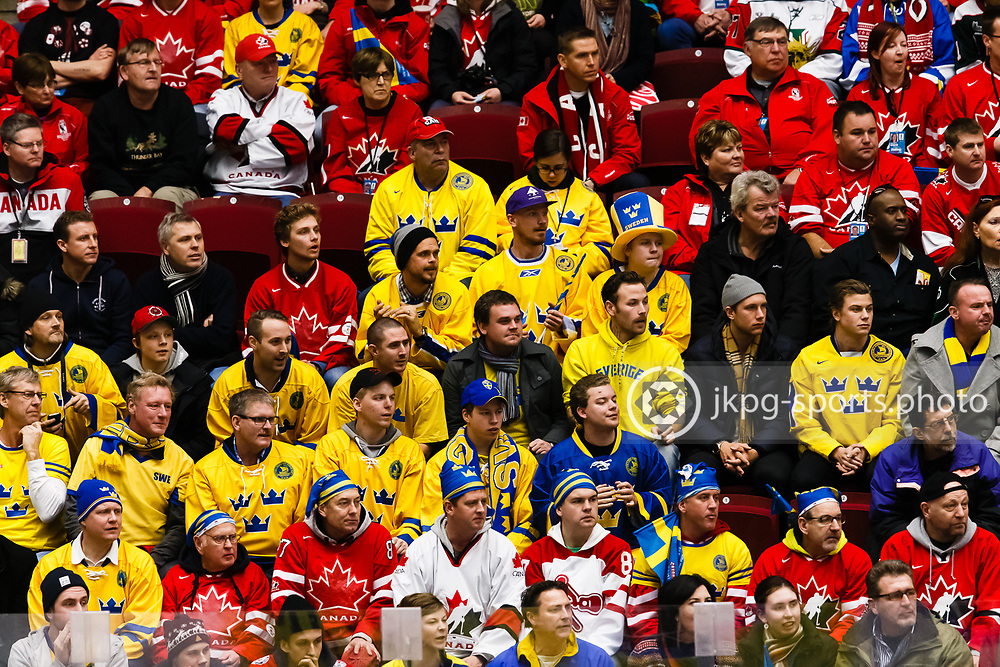 140104 Ishockey, JVM, Semifinal,  Sverige - Ryssland<br /> Icehockey, Junior World Cup, SF, Sweden - Russia.<br /> Swedish and Canadian fans together during the game.<br /> Svenska och Kanadensiska fans/supportrar tillsammans i publiken.<br /> Endast f&ouml;r redaktionellt bruk.<br /> Editorial use only.<br /> &copy; Daniel Malmberg/Jkpg sports photo