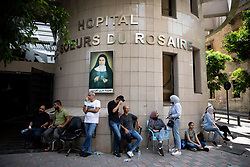© Licensed to London News Pictures. 10/08/2020. Beirut, Lebanon. People wait outside the Hopital des Soeurs du Rosaire during the aftermath around Beirut city centre following an explosion in Beirut port on Tuesday 4 August. Photo credit : Tom Nicholson/LNP