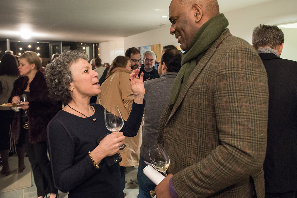 Guests mingle and eat at Joan Nathan's house  in Washington DC Jan 25,  2018. Guest's talked about how and why Sips and sSuppers got started and how it continues to help feed the poor via Martha's Table and DC Kitchen with located in Washington DC.