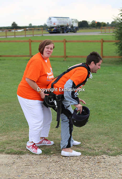 """ExCLUSIVE<br /> Celebrity big Brother Star George Gilby jumped from a plane yesterday in Northampton for Charity,<br /> <br /> George who was also seen with Big Brother star Dee kelly at the event <br /> finally plucked up the courage after a couple of hours of training, was taking part for """"Muscular Dystrophy""""<br /> ©Exclusivepix"""