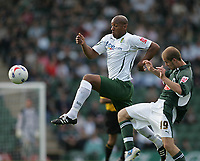 Photo: Lee Earle.<br /> Plymouth Argyle v Norwich City. Coca Cola Championship. 23/09/2006. Norwich's Dion Dublin (L) gets the better of Marcel Seip.