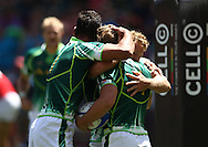 Chris Dry of South Africa and Werner Kok of South Africa congratulate Kwagga Smith of South Africa for scoring a try during the HSBC Sevens World Series Port Elizabeth Leg held at the Nelson Mandela Bay Stadium on 7th December 2013 in Port Elizabeth, South Africa. Photo by Shaun Roy/Sportzpics