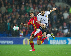 12.10.2012, Cardiff City Stadium, Cardiff, WAL, FIFA WM Qualifikation, Wales vs Schottland, im Bild Wales' Craig Davies in action against Scotland's Gary Caldwell during during FIFA World Cup Qualifier Match between Wales and Scotland at the Cardiff City Stadium, Cardiff, Wales on 2012/10/12. EXPA Pictures © 2012, PhotoCredit: EXPA/ Propagandaphoto/ David Rawcliffe..***** ATTENTION - OUT OF ENG, GBR, UK *****