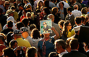 A family member of a victim of the World Trade Center attack holds a picture of her loved one at the site of the disaster on the fourth anniversary of the attack in New York September 11, 2005.