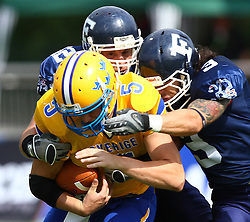 25.07.2010, Wetzlar Stadion, Wetzlar, GER, Football EM 2010, Team Sweden vs Team France, im Bild Anders Hermodsson, (Team Sweden, QB, #5) wird von Cedric Cotar, (Team France, LB, #42) und Arnaud Vidaller, (Team France, DB, #3) getackled,  EXPA Pictures © 2010, PhotoCredit: EXPA/ T. Haumer / SPORTIDA PHOTO AGENCY