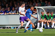 AFC Wimbledon defender Nesta Guinness-Walker (18) battles for possession during the EFL Sky Bet League 1 match between AFC Wimbledon and Shrewsbury Town at the Cherry Red Records Stadium, Kingston, England on 14 September 2019.