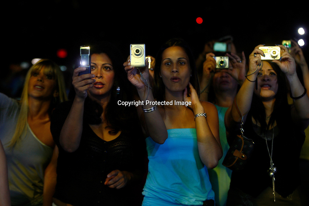 Fans cheer as singer Marc Anthony performs at Madison Square Garden in New York, August 21, 2008. Fybish was facing eviction for having an overcrowded apartment. Photo by Keith Bedford for The New York Times