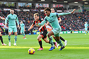 Alex Iwobi (17) of Arsenal is chased by Ryan Fraser (24) of AFC Bournemouth during the Premier League match between Bournemouth and Arsenal at the Vitality Stadium, Bournemouth, England on 25 November 2018.