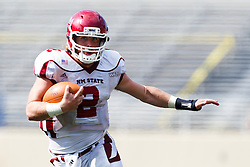 September 24, 2011; San Jose, CA, USA; New Mexico State Aggies quarterback Matt Christian (2) rushes up field against the San Jose State Spartans during the third quarter at Spartan Stadium. San Jose State defeated New Mexico State 34-24.