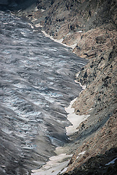 The Aletsch Glacier (German: Aletschgletscher) or Great Aletsch Glacier (German: Grosser Aletschgletscher) is the largest glacier in the Alps. It has a length of about 23 km (14 mi) and covers more than 120 square kilometres (46 sq mi) in the eastern Bernese Alps in the Swiss canton of Valais. The Aletsch Glacier is composed of three smaller glaciers converging at Concordia, where its thickness is estimated to be near 1 km (3,300 ft). It then continues towards the Rhone valley before giving birth to the Massa River.<br /> <br /> The whole area, including other glaciers is part of the Jungfrau-Aletsch Protected Area, which was declared a UNESCO World Heritage site in 2001.