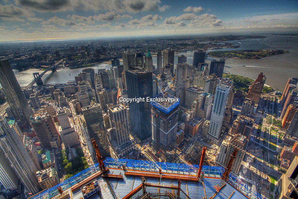 Ninety floors... and counting: The breathtaking views from One World Trade Center (and there's still 14 storeys to go)<br /> <br /> When it is completed, it will be the tallest building in Manhattan and one of incredible poignancy for New York City.&nbsp;<br /> One World Trade Center reached its 90th floor this week - with just 14 more floors to go until the top. The structure can now be seen from all five boroughs of the city. <br /> Stunning pictures showed how the area has been reborn since the 9/11 attacks more than a decade ago where almost 3,000 people lost their lives in the worst ever terrorist attack on American soil.<br /> One World Trade Center is on track to be completed by 2013 with construction workers approximately finishing a floor a week in downtown Manhattan.<br /> Electrical contractors at the tower agreed to give it a festive feel and wrapped the exterior lamps they use with coloured cellophane in time for Christmas.&nbsp; <br /> <br /> Developments can be followed on One World Trade Center's Twitter feed @WTCProgress. Glass now covers up to the 65th floor and concrete has been added up to the 82nd level. There will be 104 floors in the completed building, making it the tallest in Manhattan.<br /> The site will be a place of reflection and contemplation for many and The National September 11 Memorial And Museum, designed by the winning team of Michael Arad and Peter Walker, was opened for the 10th anniversary of the terrorist attacks.<br /> One World Trade Center, designed by renowned architect David Childs, standing in the north-west corner, is the site&rsquo;s centrepiece. The first cornerstone was laid down on July 4 2004 and as the building rose it was known as Freedom Tower.<br /> <br /> It stands in the footsteps of the original twin towers among a small forest of oak trees in an eight-acre plaza. It features two 50ft-deep pools, each containing fountains, along with a museum with exhibitions and artefacts to teach visitors about the events of September 11.<br /> At One World Trade Center, there is almost 3million square feet of