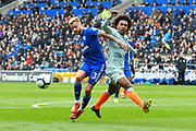 Joe Bennett (3) of Cardiff City battles for possession with Willian (22) of Chelsea and wins the ball during the Premier League match between Cardiff City and Chelsea at the Cardiff City Stadium, Cardiff, Wales on 31 March 2019.