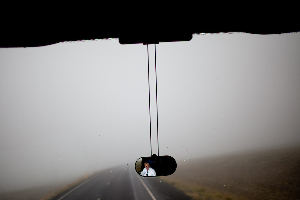 A bus driver navigating fog-enveloped roads in the Haukadalur region, Iceland.