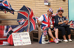 © Licensed to London News Pictures . 17/07/2013 . London, UK . Royalist fans Terry Hutt and Nadine Samai await outside the Lindo Wing at St Mary's Hospital in Paddington, London, for the arrival of the Duchess of Cambridge, who is due to give birth her first baby at anytime from now. Photo credit : Isabel Infantes/LNP