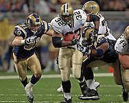 New Orleans running back Antowain Smith (32) brakes up field past St. Louis Rams defenders Pisa Tinoisamoa (R) and Adam Archuleta (31) during the second quarter at the Edward Jones Dome in St. Louis, Missouri, October 23, 2005.  The Rams beat the Saints 28-17.