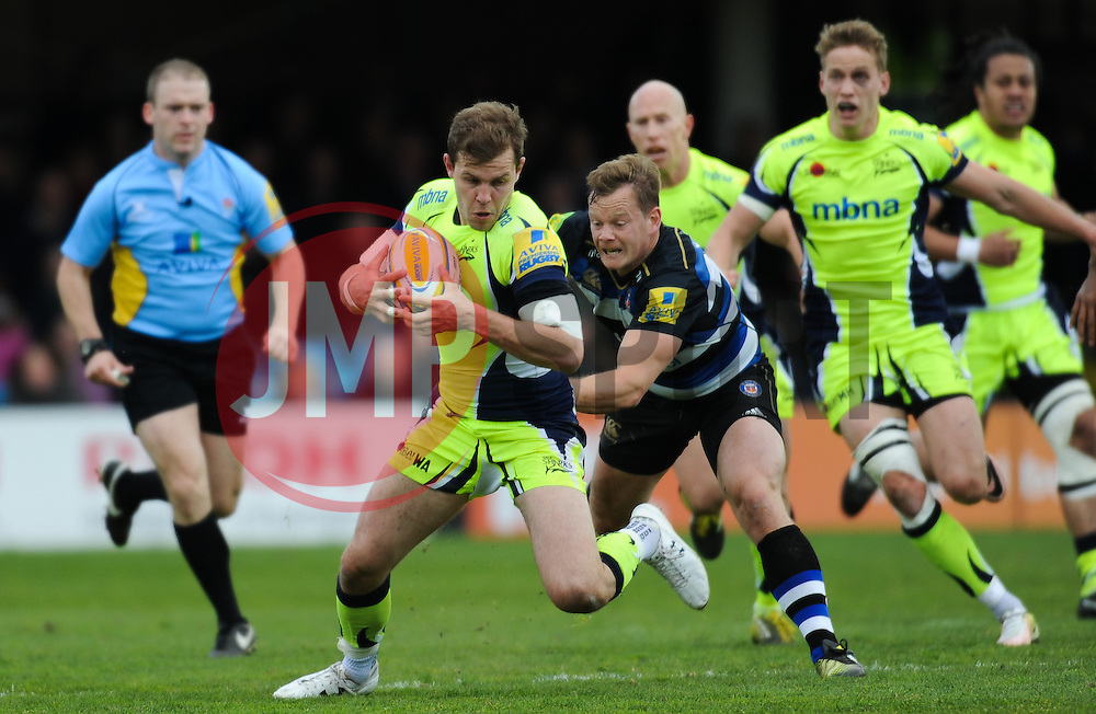 Will Addison of Sale Sharks is tackled by Chris Cook of Bath Rugby.  - Mandatory by-line: Alex Davidson/JMP - 23/04/2016 - RUGBY - Recreation Ground - Bath, England - Bath Rugby v Sale Sharks - Aviva Premiership