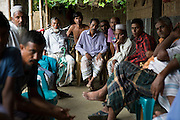 At Borezerdanga village in one of the enclaves near the town of Debiganj a meeting is being held between village elders and men known as 'peace keepers'. Here to discuss the issue of an underage marriage, until a few weeks ago when the enclaves were disbanded the Bangladeshi police had no jurisdiction inside the enclaves so residents relied on peace keepers to sort out problems ranging from illegal logging to land disputes.<br /> <br /> On July 31st 2015 the enclaves that formed one of the world's most complicated borders were officially absorbed in to the countries that surrounded them in a land-mark land swap between India and Bangladesh. The people that lived in them will finally receive citizenship.<br /> <br /> Enclaves are small pockets of sovereign land completely surrounded by another sovereign nation. Approximately 160 enclaves, known as chitmahals, exist on either side of the India-Bangladesh border. For 68 years the 50,000 plus inhabitants of these enclaves have lived a difficult existence, stranded from their home nation and ignored by the country that surrounds them. <br /> <br /> In theory even leaving their enclaves is illegally crossing an international border and for decades it has been very difficult for them to receive even the most basic of rights whether education or health. Even the police have no jurisdiction in the enclaves leaving them essentially lawless.