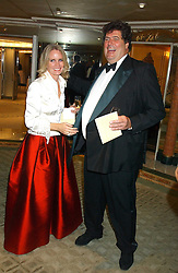 MR & MRS TIM HOARE at the Chain of Hope 10th Anniversary Ball held at The Dorchester, Park Lane, London on 1st November 2005.<br />