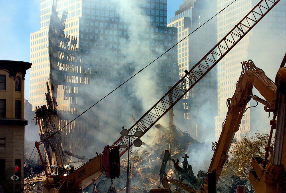 Steel workers and rescue personnel continue the lengthy process of dismantling the remains of the World trade Towers just days after the attacks ready to search the areas below.