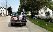 Riding in the bed of a pick-up, Jeff Odhner of Amherst, N.H., dressed as Uncle Sam on long stilt legs, gets a lift to the Amherst 4th of July parade staging area, Monday, July 4, 2011.  Republican 2012 presidential hopeful, former Massachusetts Gov. Mitt Romney and Republican 2012 presidential hopeful, Former Utah Gov. Jon Huntsman marched in the campaign section of the parade.  (Cheryl Senter for the New York Times)
