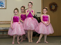"""The """"flowers"""" wait in the wings for their waltz as the Lakes Region Dance company brings their production of the Nutcracker to the Taylor Home on Monday evening.  (Karen Bobotas/for the Laconia Daily Sun)"""