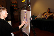 Artist Elizabeth Swisher works on a pastel drawing of model Stephanie Elsass during the 2011 Art Ball at the Dayton Art Institute, Saturday, June 11, 2011.
