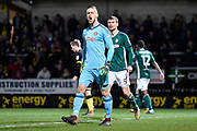 Brentford goalkeeper Daniel Bentley (1) and Brentford defender Andreas Bjelland (5) argue a decision with the match official during the EFL Sky Bet Championship match between Burton Albion and Brentford at the Pirelli Stadium, Burton upon Trent, England on 6 March 2018. Picture by Richard Holmes.