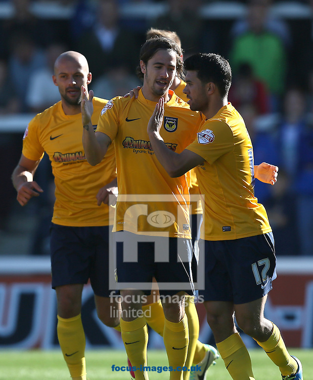 Picture by Paul Gaythorpe/Focus Images Ltd +447771 871632<br /> 28/09/2013<br /> Danny Rose (R) congratulates  Ryan Williams (L) of Oxford United on scoring the first goal against Hartlepool United during the Sky Bet League 2 match at Victoria Park, Hartlepool.