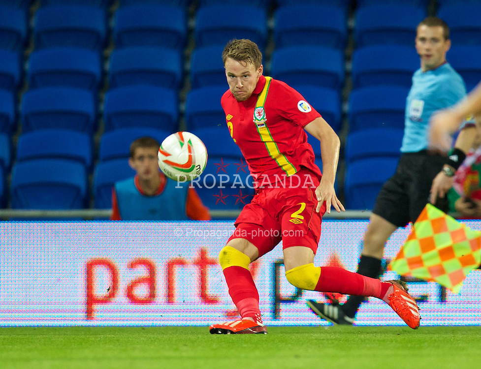 CARDIFF, WALES - Tuesday, September 10, 2013: Wales' Chris Gunter in action against Serbia during the 2014 FIFA World Cup Brazil Qualifying Group A match at the Cardiff CIty Stadium. (Pic by David Rawcliffe/Propaganda)