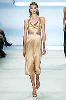 Anja Leuenberger walks the runway wearing Cushnie et Ochs Fall 2016, hair by Antonio Corral Calero for Moroccanoil, makeup by Val Garland, photographed by Thomas Concordia during New York Fashion Week on February 12, 2016