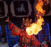 China, Sichuan. Chengdu. Sichuan Opera Chengdu Shufengya Yun. Face changing and fire spitting.