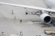 airplane being loaded while standing at the gate Narita Airport Japan