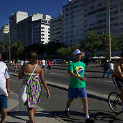 Walkers and bike riders exercise early on Sunday morning at Copacabana Beach. On Sunday's the main roads along the beaches of Copacabana, Leblon and Ipanema are closed to traffic bringing out thousands of people of all ages to walk, run, jog, ride, skateboard and cycle more than 10 km of beachside roadway. Rio de Janeiro,  Brazil. 4th July 2010. Photo Tim Clayton...