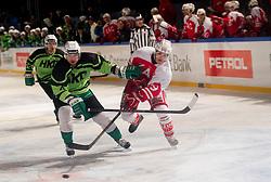 08.01.2012, Stadium Bezigrad, Ljubljana, SLO, EBEL, HDD Telemach Olimpija Ljubljana vs KAC Klagenfurt 40. Runde, in picture Igor Cvetek (HDD Telemach Olimpija, #4) vs Stephan Geier of KAC during the Erste Bank Ice Hockey League in 40th Round match between HDD Telemach Olimpija Ljubljana and KAC Klagenfurt at the open ice winter classic Stadium Bezigrad, Ljubljana, Slovenia on 2013/01/08. (Photo By Vid Ponikvar / Sportida.com)