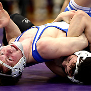 Perrysburg's Blake Saito, bottom, tries to keep Anthony Wayne's Zack Snyder down as the two wrestle at 132 pounds during the championship round at the Northern Lakes League high school wrestling tournament hosted at Maumee High School in Maumee, Ohio, on Saturday, February 16, 2019. THE BLADE/KURT STEISS <br /> SPT NLLwrestle17p
