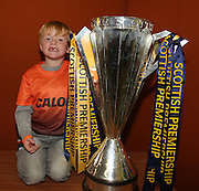 Five year old Liam Byrne gets his hands on the Scottish Premiership trophy - Dundee United open day at Tannadice<br /> <br />  - Pictures © David Young