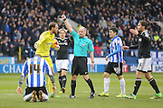Referee Graham Scott sends off Brentford defender Yoann Barbet for his foul on Sheffield Wednesday forward Gary Hooper  during the Sky Bet Championship match between Sheffield Wednesday and Brentford at Hillsborough, Sheffield, England on 13 February 2016. Photo by Simon Davies.